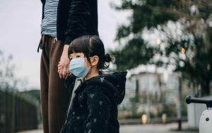 Little girl wearing face mask