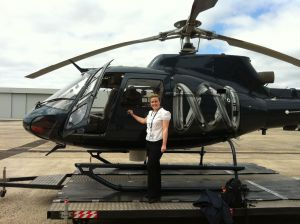 Emily standing by an ABC news Helicopter