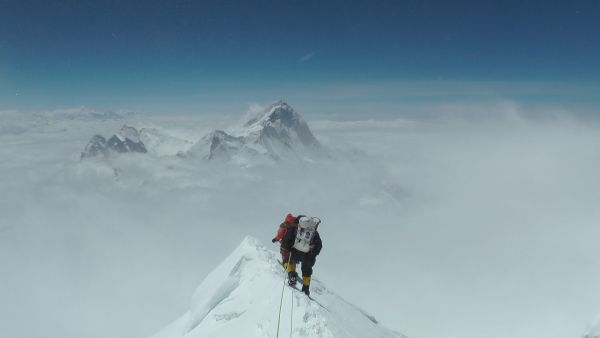 Paul (in black) and fellow expedition member descending from the summit of Mount Everest in 2011