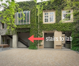 Stairs to lab with arrow showing entrance