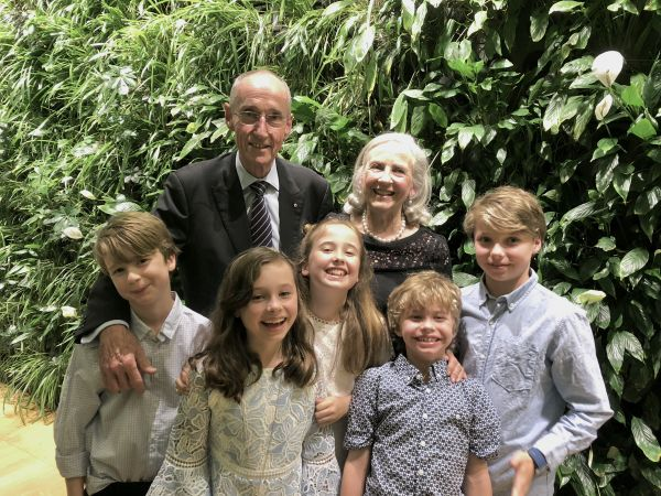 David with his wife, Maureen, and grandchildren (L-R: Angus, May, Amelia, Gil and Wilson)